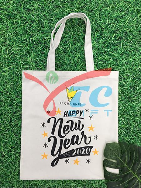 TÚI CANVAS MÀU TRẮNG TẨY XI CHA HAPPY NEW YEAR